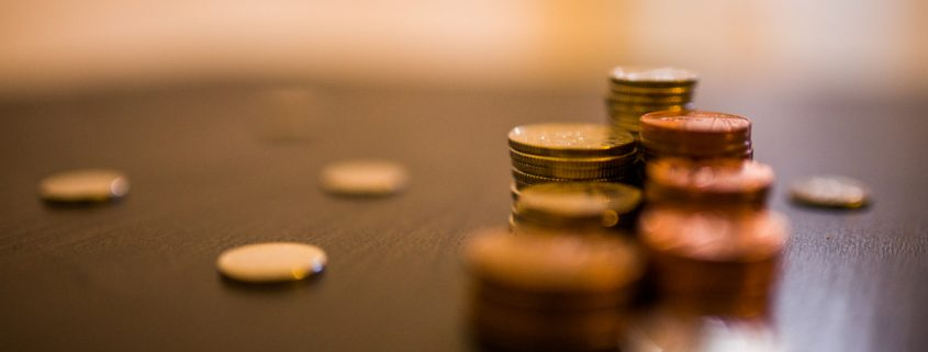 An image of coins stacked on a desk in our tax changes news piece