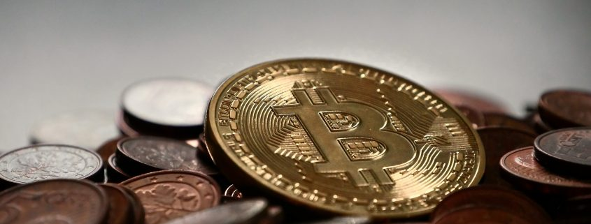 An image of a coin with Bitcoin branding.